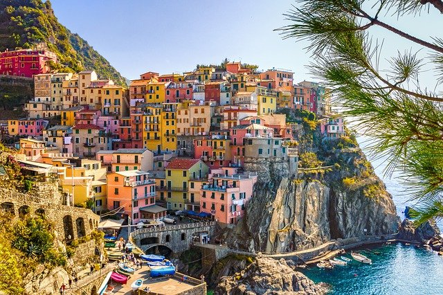 italy,sea,houses,cinque terre,mediterranean,liguria,village,travel,vacations,summer,water,hills,mountain,city,italian,colorful,architecture,